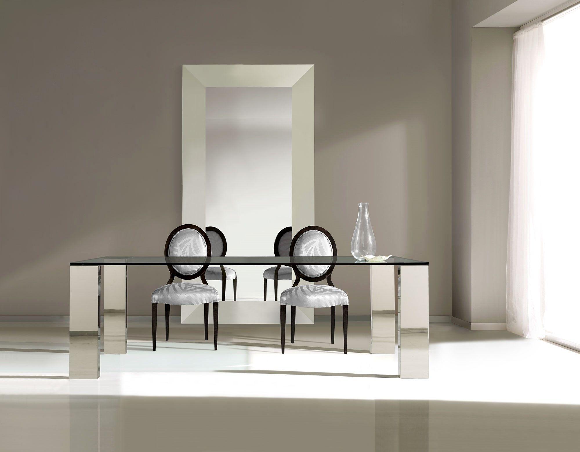 mesa de comedor de acero y cristal